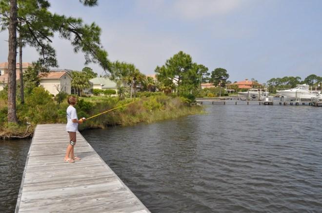 Abbi fishing in the backyard - in the bay...